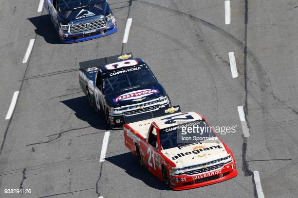 Johnny Sauter GMS Racing Chevrolet Silverado Allegiant Airlines leads John Hunter Nemechek NEMCO Motorsports Chevrolet Silverado into Turn 1 during...