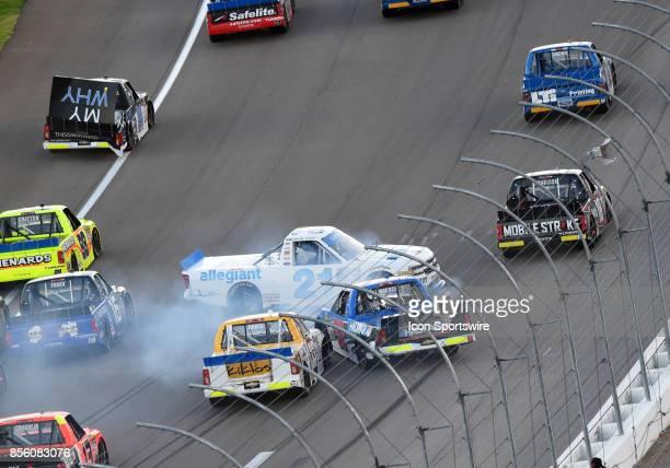 Johnny Sauter GMS Racing Chevrolet Silverado crashes into Stewart Friesen Chris Larsen Chevrolet Silverado and Kaz Grala GMS Racing Chevrolet...