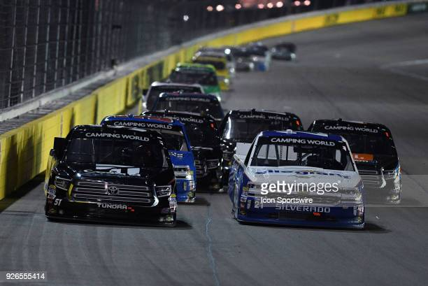 Johnny Sauter GMS Racing Chevrolet Silverado dives inside of Kyle Busch KBM Toyota Tundra down the back stretch during the NASCAR Camping World Truck...