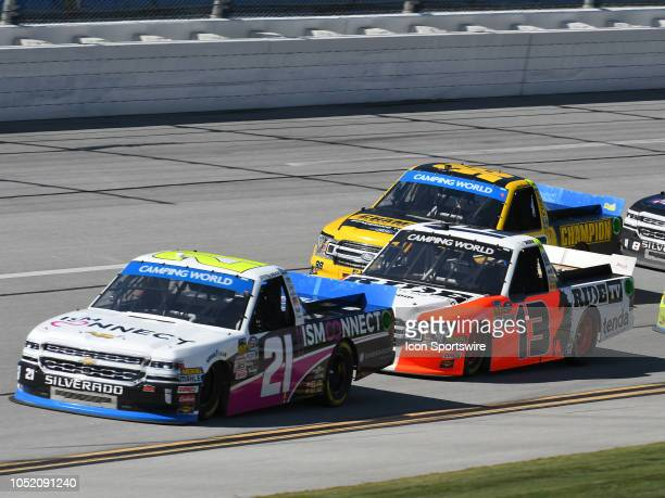 Johnny Sauter GMS Racing Chevrolet Silverado ISM Connect leads Myatt Snider ThorSport Racing Ford F150 Ride TV/ Louisiana Hot Sauce during the NASCAR...