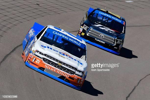 Johnny Sauter GMS Racing Chevrolet Silverado leads Brett Moffitt Shigeaki Hattori Toyota Tundra in practice for the World of Westgate 200 NASCAR...