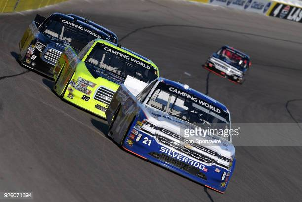 Johnny Sauter GMS Racing Chevrolet Silverado leads Matt Crafton ThorSport Ford F150 and Spencer Davis Kyle Busch Motorsports Toyota Tundra down the...