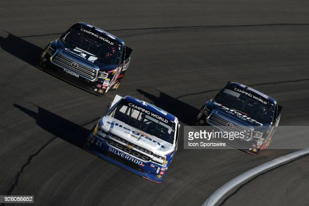 Johnny Sauter GMS Racing Chevrolet Silverado leads Spencer Davis Kyle Busch Motorsports Toyota Tundra and Noah Gragson Kyle Busch Motorsports Toyota...