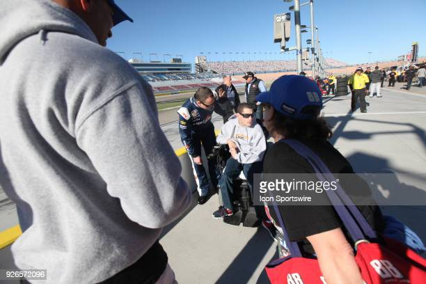 Johnny Sauter GMS Racing Chevrolet Silverado meets with a fan during practice for the NASCAR Camping World Truck Series Inaugural Stratosphere 200 on...