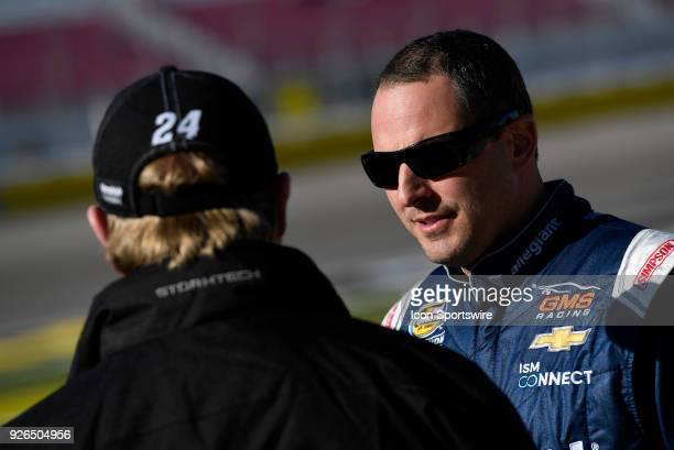 Johnny Sauter GMS Racing Chevrolet Silverado talks with his crew during qualifying for the NASCAR Camping World Truck Series Stratosphere 200 on...