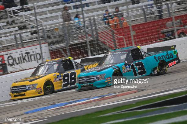 Johnny Sauter ThorSport Racing Ford F150 and Grant Enfinger ThorSport Racing Ford F150 Champion Power Equipment battle for position during the 11th...