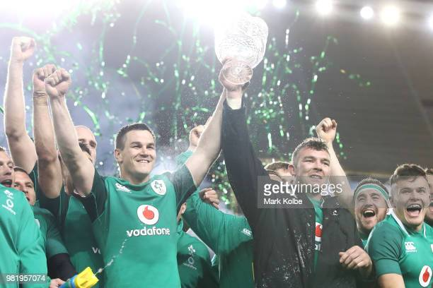 Johnny Sexton and Peter O'Mahony of Ireland hold the trophy up as Ireland celebrate victory after winning the series and the Third International Test...