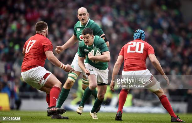 Johnny Sexton of Ireland and Justin Tipuric and Wyn Jones of Wales during the Six Nations Championship rugby match between Ireland and Wales at Aviva...