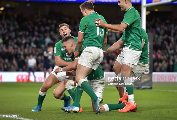 Johnny Sexton of Ireland celebrates with Jordan Larmour and Garry Ringrose after scoring his sides first try during the 2020 Guinness Six Nations...
