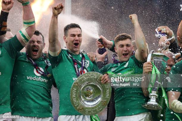 Johnny Sexton of Ireland celebrates with The Triple Crown Trophy after the NatWest Six Nations match between England and Ireland at Twickenham...