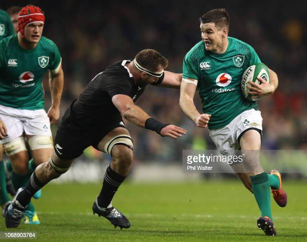 Johnny Sexton of Ireland is tackled by Kieran Read of New Zealand All Blacks during the international friendly between Ireland and New Zealand at...