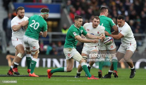 Johnny Sexton of Ireland passes the ball watched by Sam Underhill and Ellis Genge during the 2020 Guinness Six Nations match between England and...