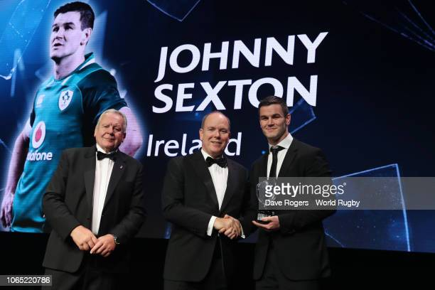 Johnny Sexton of Ireland receives the World Rugby via Getty Images Men's 15s Player of the Year award in association with Mastercard from Bill...