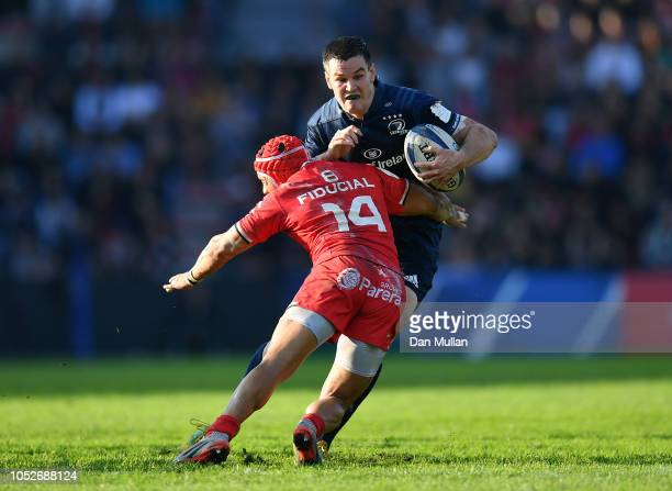 Johnny Sexton of Leinster is tackled by Cheslin Kolbe of Toulouse during the Champions Cup match between Toulouse and Leinster Rugby at Stade...