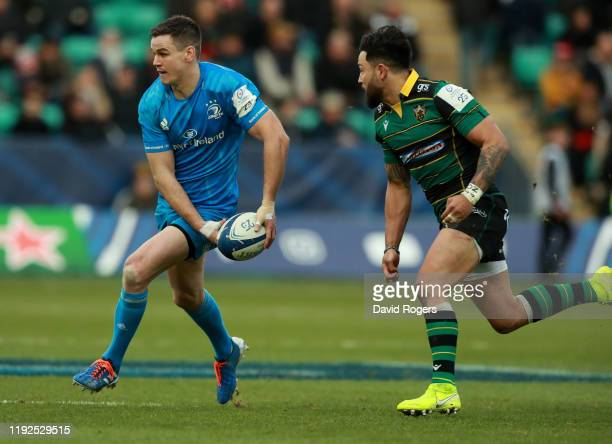 Johnny Sexton of Leinster runs with the ball during the Heineken Champions Cup Round 3 match between Northampton Saints and Leinster Rugby at...