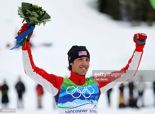 Johnny Spillane of United States celebrates in the flower ceremony after winning the silver medal during the Nordic Combined Men's Individual 10km on...