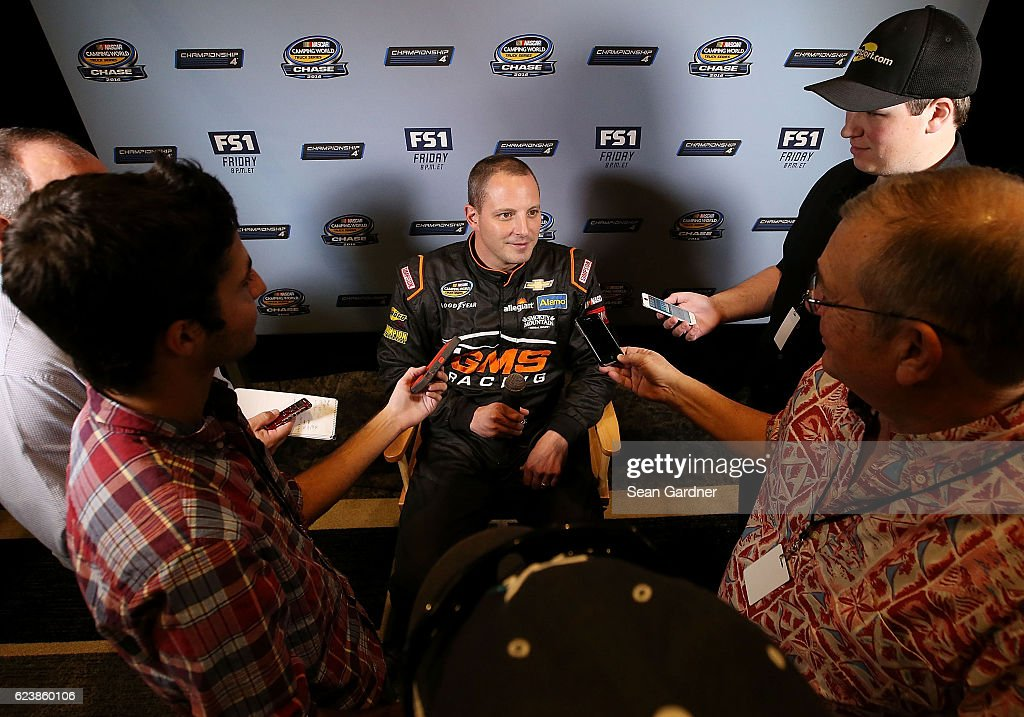 Johnny Suater, driver of the #21 Allegiant Travel Chevrolet, talks to the media during media day for the NASCAR Camping World Truck Series Championship at the Loews Hotel on November 17, 2016 in Miami Beach, Florida.