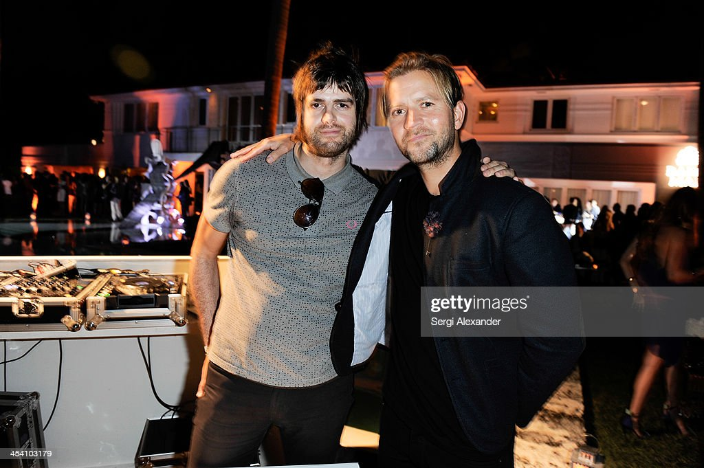 DJ Johnny The Boy and guest attend Niche Media Party Hosted By Zoe Saldana on December 6, 2013 in Miami Beach, Florida.