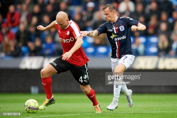 Johnny Thomsen of Randers FC and Jakob Ankersen of AGF Arhus compete for the ball during the Danish Superliga match between Randers FC and AGF Arhus...