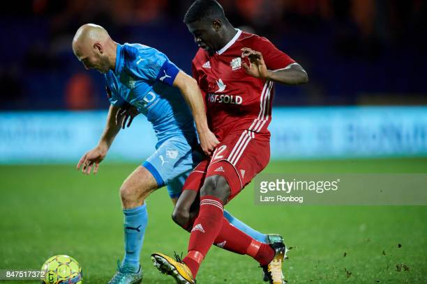 Johnny Thomsen of Randers FC and Mayron George of Lyngby BK compete for the ball during the Danish Alka Superliga match between Randers FC and Lyngby...
