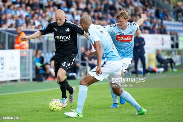 Johnny Thomsen of Randers FC and Simon Poulsen of SonderjyskE compete for the ball during the Danish Alka Superliga match between SonderjyskE and...