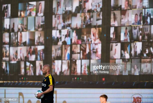 Johnny Thomsen of Randers FC in front of the LED Screens with fans following the game via zoom during the Danish 3F Superliga match between AGF...
