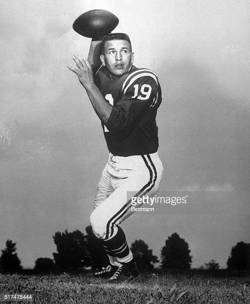 Johnny Unitas is shown in a posed action shot about to throw the football