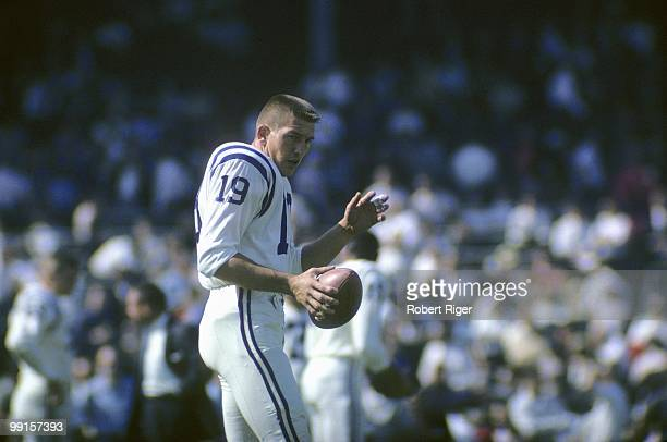 Johnny Unitas of the Baltimore Colts looks on during the game against the Chicago Bears at Wrigley Field on October 6 1963 in Chicago Illinois