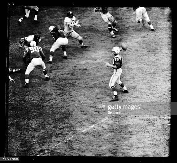 Johnny Unitas of the Baltimore Colts passes during the ProChampionship game won by Baltimore over the NY Giants 3116