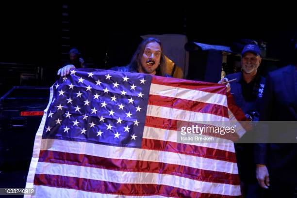Johnny Van Zant of Lynyrd Skynyrd displays an American flag during the 2018 iHeartRadio Music Festival at TMobile Arena on September 22 2018 in Las...