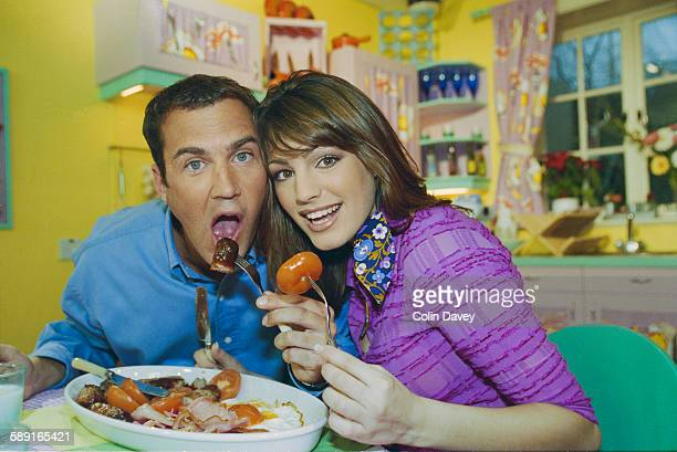 Johnny Vaughan, presenter of Channel 4 morning television show 'The Big Breakfast', with his new co-host Kelly Brook at the studio in East London,...