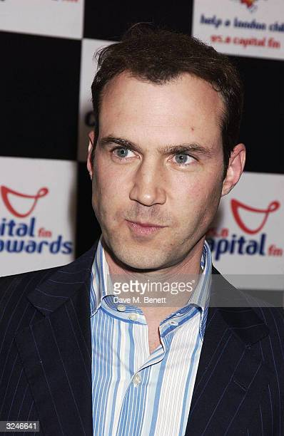 """Johnny Vaughn poses in the awards room at the """"Capital FM Awards 2004"""" at the Royal Lancaster Hotel on April 7, 2004 in London. The awards celebrate..."""