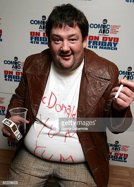 Johnny Vegas poses in the press room during 'Comic Aid' a comedy night with proceeds going to the Disasters Emergency Committee to raise funds for...