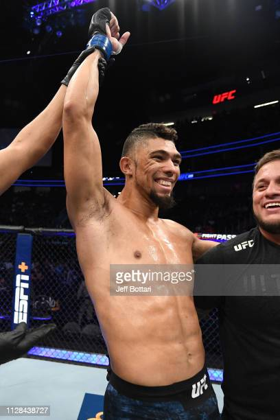 Johnny Walker of Brazil celebrates his win over Misha Cirkunov of Latvia in their light heavyweight bout during the UFC 235 event at TMobile Arena on...