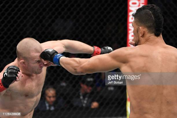 Johnny Walker of Brazil punches Misha Cirkunov of Latvia in their light heavyweight bout during the UFC 235 event at TMobile Arena on March 2 2019 in...