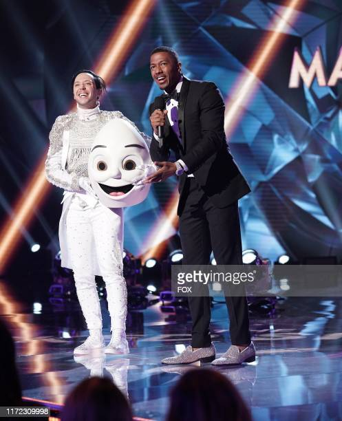 Johnny Weir and host Nick Cannon in the Season Two Premiere episode of THE MASKED SINGER airing Wednesday Sept 25 on FOX