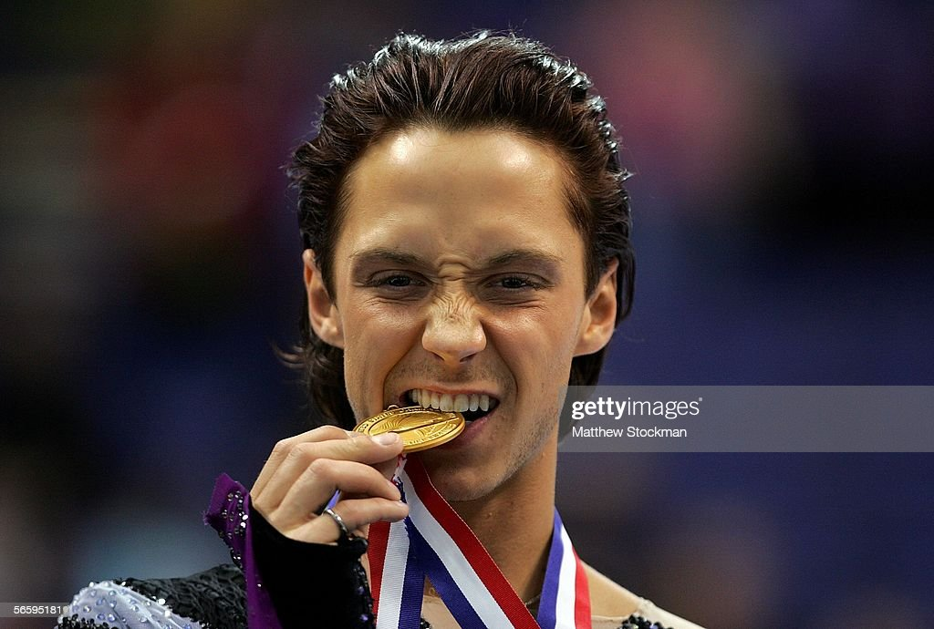 Johnny Weir bites his gold medal on the podium at the 2006 State Farm U.S. Figure Championships at the Savvis Center on January 14, 2006 in St. Louis, Missouri.