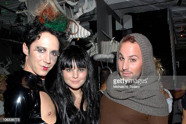 Johnny Weir Christine Staub and Micah Jesse attend the Halloween Disco Ball at Eric Alt Salon on October 28 2010 in WoodRidge New Jersey