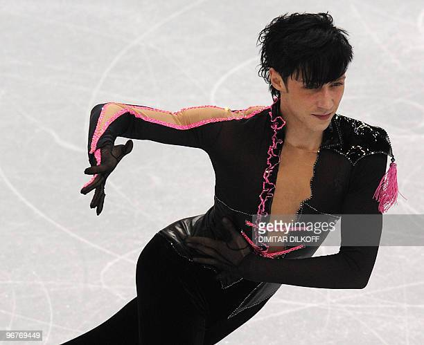 US' Johnny Weir competes in the Figure Skating Men's short program at the Pacific Coliseum in Vancouver during the XXI Winter Olympics on February 16...