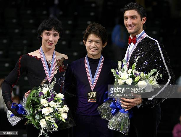 Johnny Weir of the United States , Takahiko Kozuka of Japan and Evan Lyzacek pose with their medals after the men's free skate program during the day...