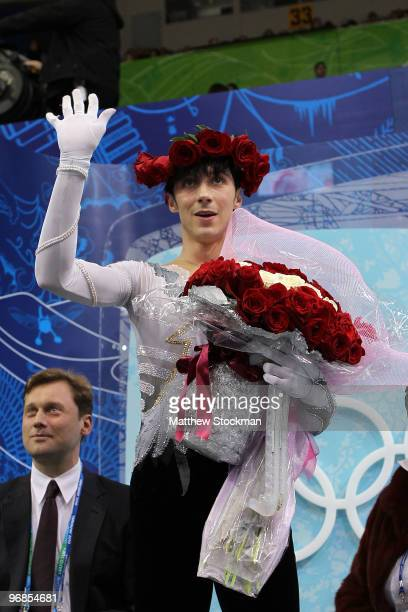 Johnny Weir of the United States waves in the kiss and cry area in the men's figure skating free skating on day 7 of the Vancouver 2010 Winter...