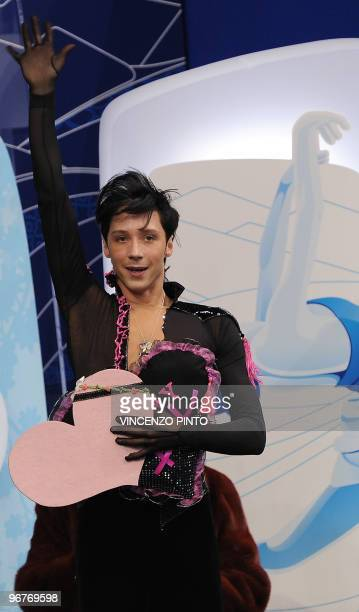 Johnny Weir of the US waves after competing in the men's Figure Skating short program at the Pacific Coliseum during the Vancouver Winter Olympics on...