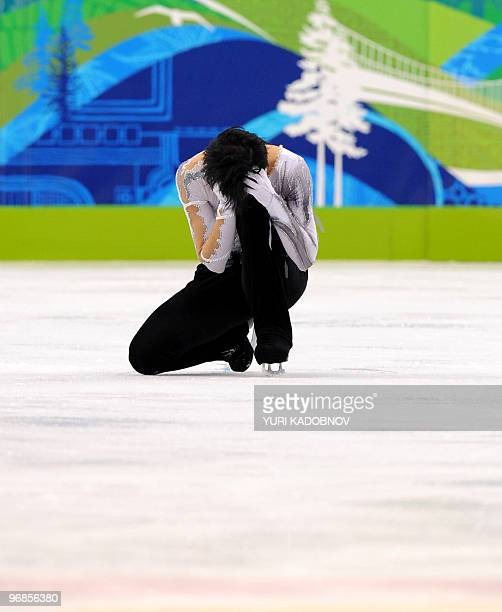US Johnny Weir performs in the Men's Figure skating free program at the Pacific Coliseum in Vancouver during the 2010 Winter Olympics on February 18...