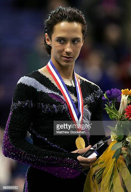 Johnny Weir stands on the podium after receiving his gold medal at the 2006 State Farm U.S. Figure Championships at the Savvis Center on January 14,...