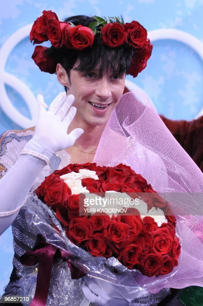 US Johnny Weir wave to the public at the kiss and cry area before listening to his results after performing in the Men's Figure skating free program...