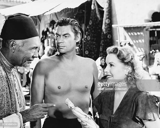 Johnny Weissmuller as Tarzan and Brenda Joyce as Jane in 'Tarzan And The Leopard Woman' directed by Kurt Neumann 1946