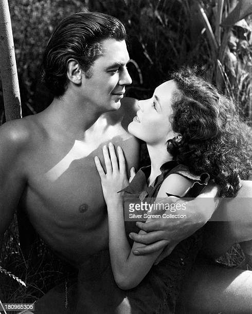 Johnny Weissmuller as Tarzan and Maureen O'Sullivan as Jane Parker in a promotional portrait for 'Tarzan Escapes' directed by Richard Thorpe 1936