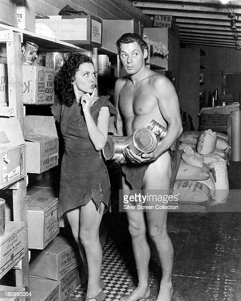 Johnny Weissmuller as Tarzan and Maureen O'Sullivan as Jane Parker stealing provisions in a publicity still for one of the six Tarzan films they made...