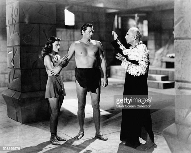 Johnny Weissmuller as Tarzan Brenda Joyce as Jane and George Zucco as Palanth the High Priest in 'Tarzan And The Mermaids' directed by Robert Florey...