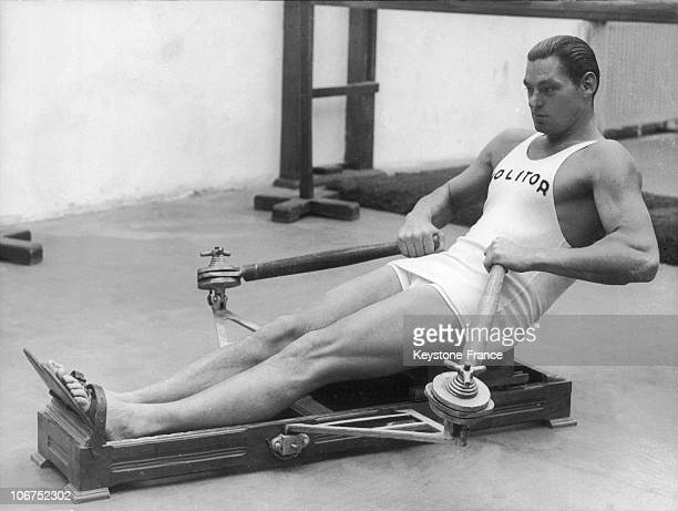 Johnny Weissmuller On A Rowing Maching In A Weight Room At The Molitor Pool In Paris In May 1930